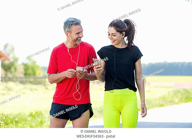 Couple using smartphones during workout