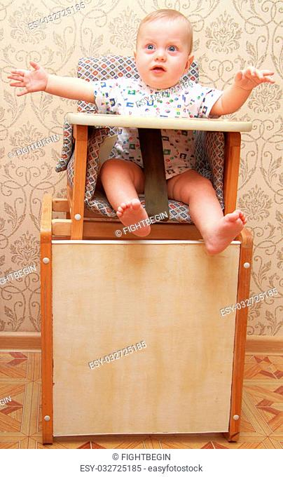 adorable baby on a highchair, at home