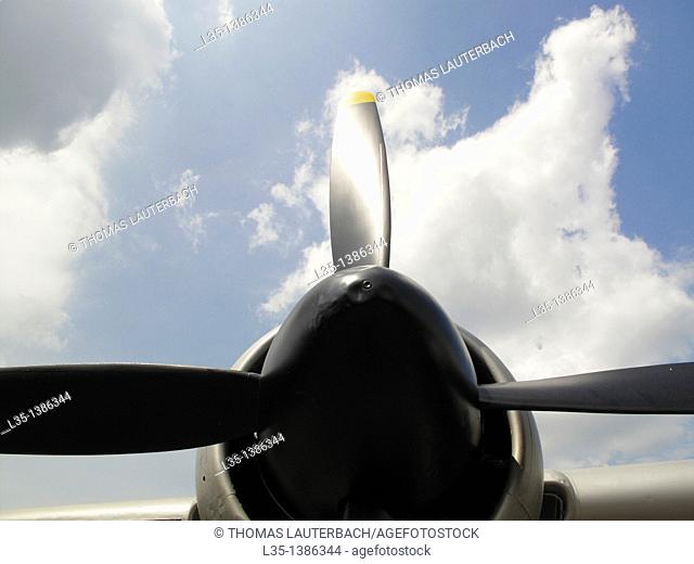 Propeller and white clouds