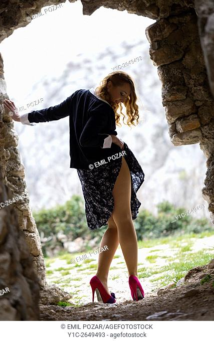 Checking under dress young woman rear-view