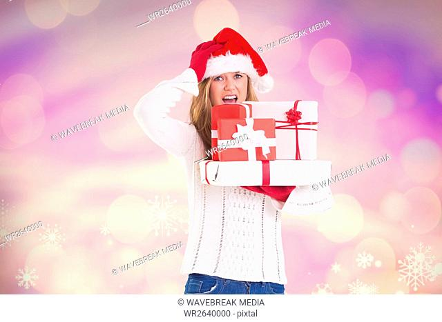 Confused woman in santa hat holding her stack of gifts