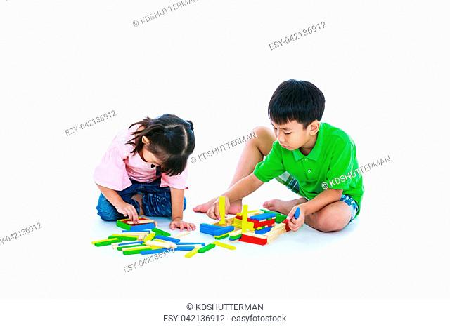 Happy asian children. Boy and girl playing toy wood blocks, isolated on white background. Educational toys for elementary and kindergarten child
