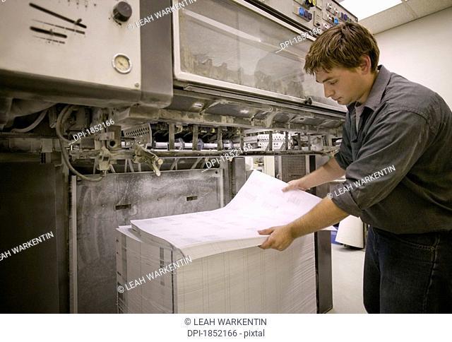 Man at a printing press
