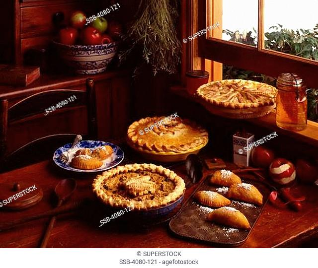 Apple pies and turnovers on kitchen table by window