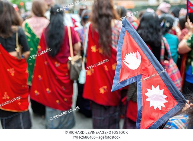 Hundreds of members of the Nepalese diaspora with their families and supporters march in New York for the first Nepal Day Parade
