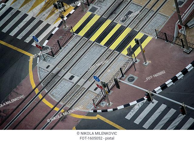 High angle view of road markings on railroad tracks and street