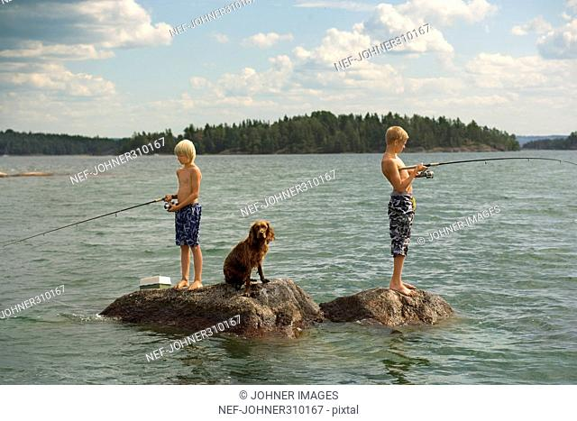 Two boys fishing in a lake