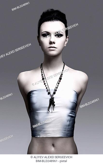 Portrait of serious Caucasian woman wearing necklace