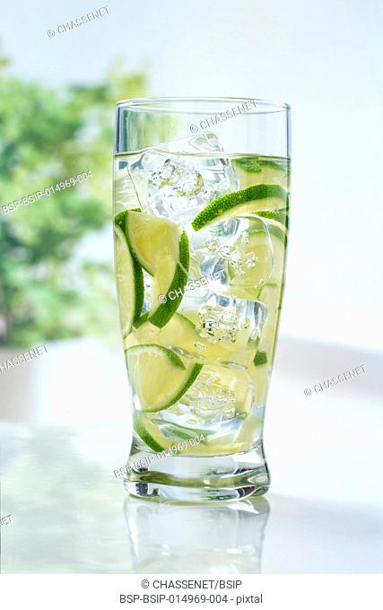 Lime slices in glass of water