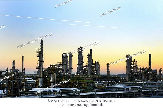 View of a part of the 'Total' oil refinery during sunset in Leuna, Germany, 12 March 2014. A general inspection under the project title 'Matrix' is being...