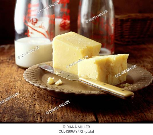 Food, dairy, mature cheddar cheese, bottles of milk, traditional farmhouse
