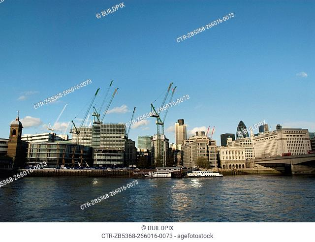 City of London skyline with construction work taking place on the riverside development of Watermark Place
