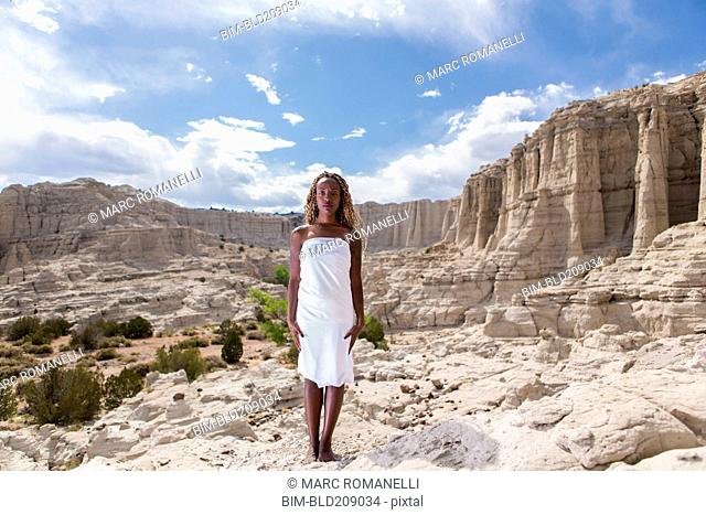 African American woman standing in rock formations, Santa Fe, New Mexico, United States