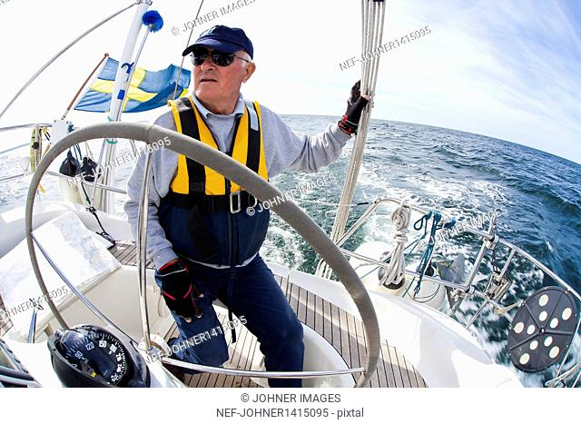 Portrait of senior sailing