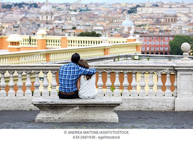 Couple observing the view from the Janiculum water fountain in Rome Italy