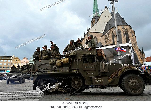 World War II re-enactors dressed as U.S. Army soldiers arrive the Republic's Square on original military cars to mark the 70th anniversary of the liberation...