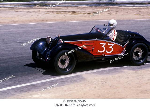 An Alfa Romeo Milano car racing at the 35th Concours D Elegance Show in Pebble Beach Carmel, CA