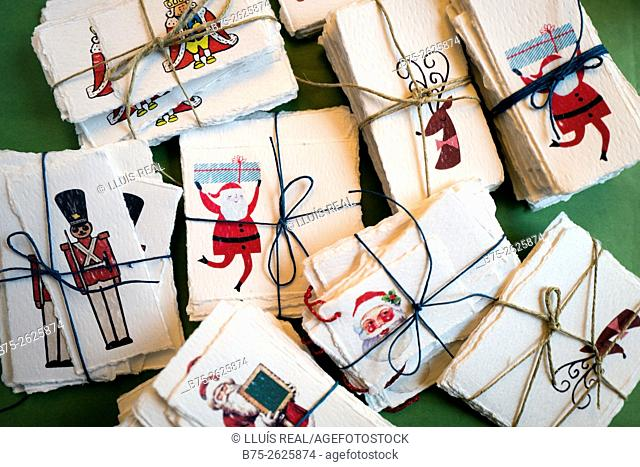 Several parcels of hand made christmas labels with a drawings of father christmas, nutcracker and rudolf