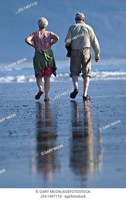 Senior couple walking on an Oregon beach