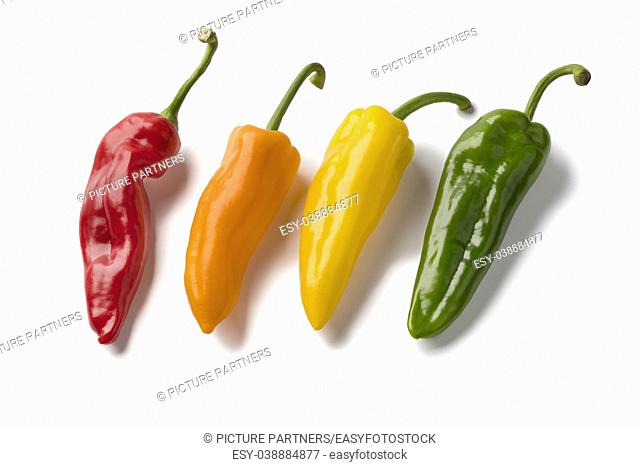 Fresh variety of red, yellow, orange and green sweet pointed peppers isolated on white background