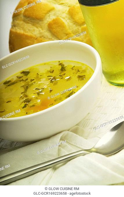 Close-up of a bowl of soup with a loaf of bread