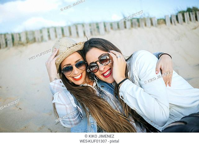 Portrait of two best friends on the beach