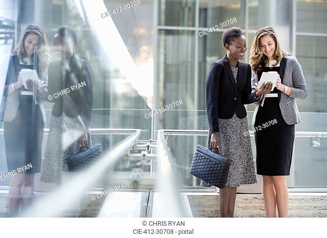 Corporate businesswomen using digital tablet