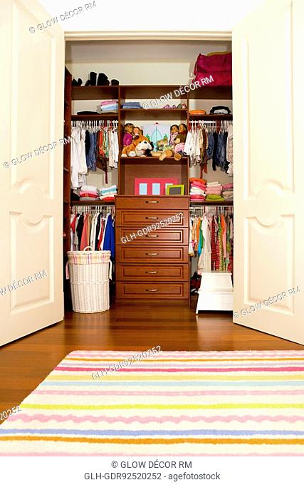 Clothes and toys in a wardrobe