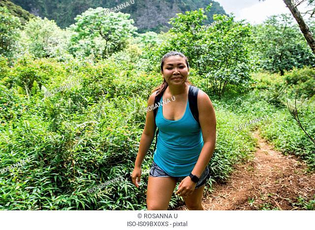 Hiker walking in rainforest, Iao Valley, Maui, Hawaii