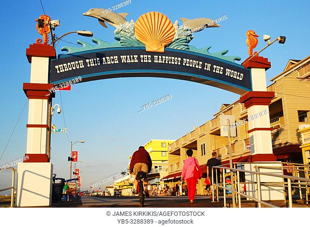 People walk and bike their way onto the Boardwalk in Wildwood, New Jersey
