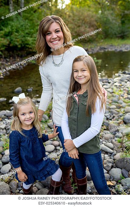 Portrait of a mother with her two daughters along the McKenzie River in Oregon