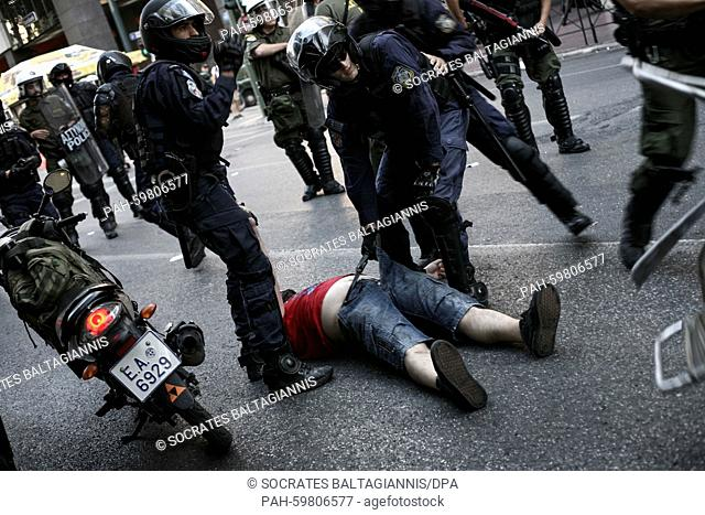 A protester is arrested by riot police during minor clashes that took place at a demonstration supporting the NO at the Sunday's referendum in Athens