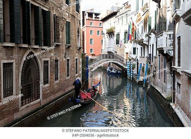 Gondoliere and Gondola in Canal, Venice, Italy