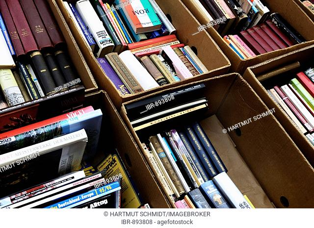 Old books in cardboard boxes, second-hand book market, flea market