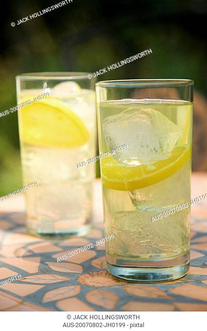 Close-up of two glasses of lemonade on a table