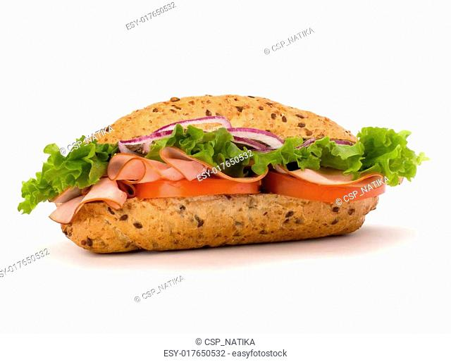 Big appetizing fast food baguette sandwich with lettuce, tomato, smoked ham and cheese isolated on white background. Junk food subway