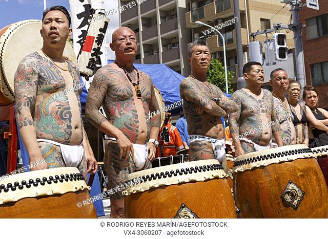 Participants showing their full body tattooed, possibly members of the Japanese mafia or Yakuza, attend the Sanja Matsuri in Asakusa district on May 20, 2018