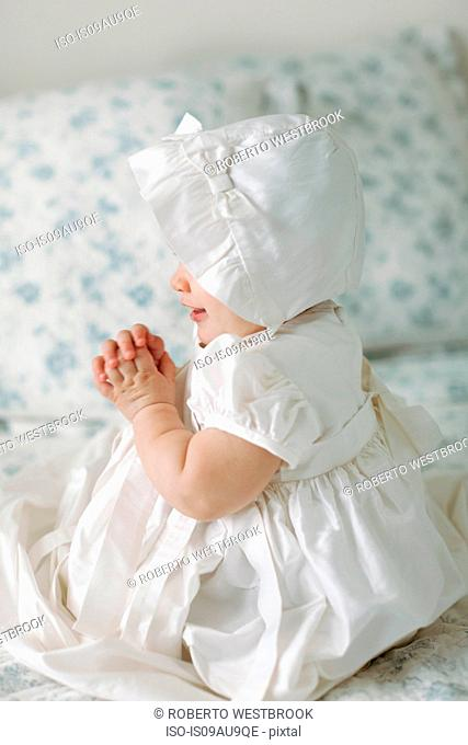 Baby girl wearing Christening gown