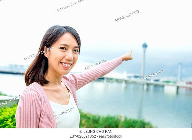 Woman pointing the Macau tower