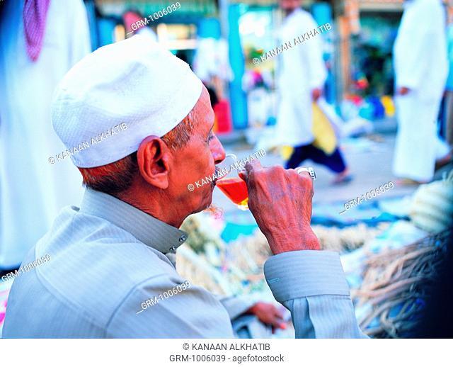 Old Merchant drinking tea in Bab Makkah, Jeddah, Saudi Arabia