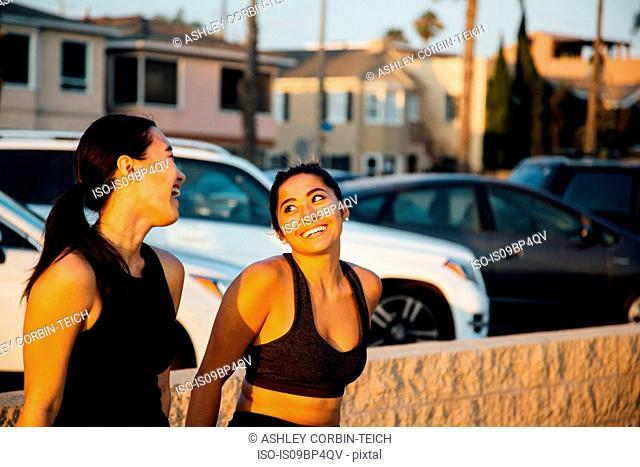 Friends talking by beach, Long Beach, California, US