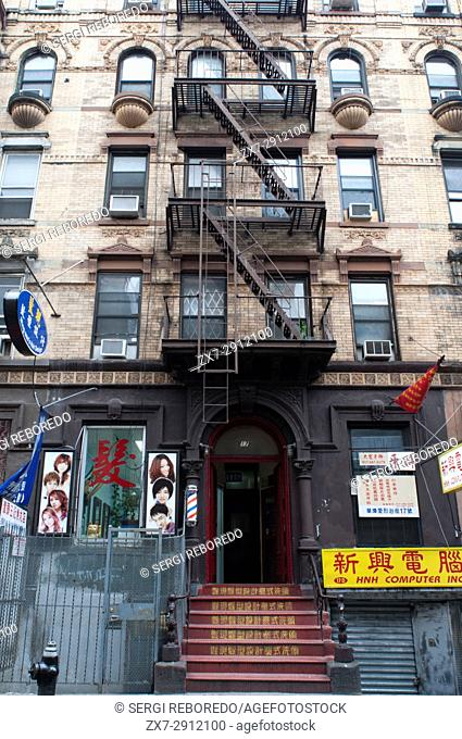 Building facades with fire escapes in China Town, New York City, USA