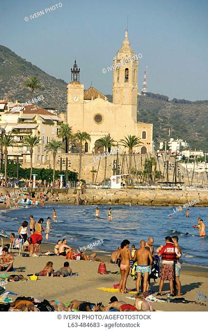 Church of Sant Bartomeu and beach. Sitges. Barcelona province, Catalonia. Spain