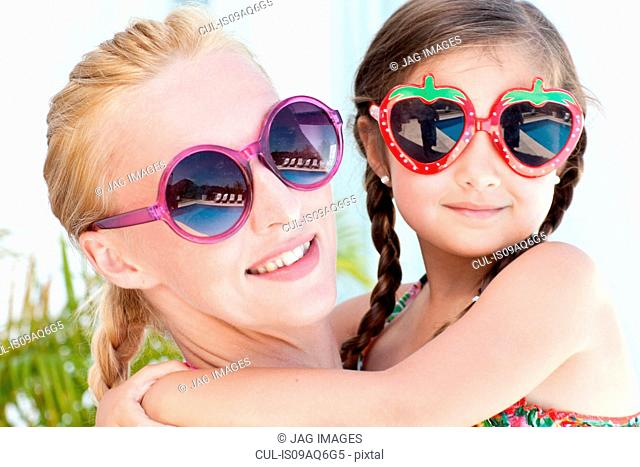 Portrait of mother and daughter, wearing sunglasses, close-up