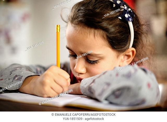 Child exercise the tasks of school