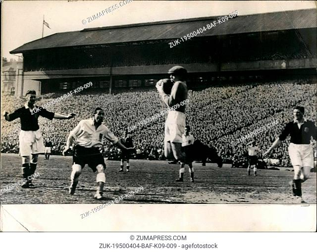 Apr. 04, 1950 - England bear Scotland at Hampden Park: Photo shows Cowan the Scottish goalkeeper clutches a high drive watched by (left to right) Woodburn...