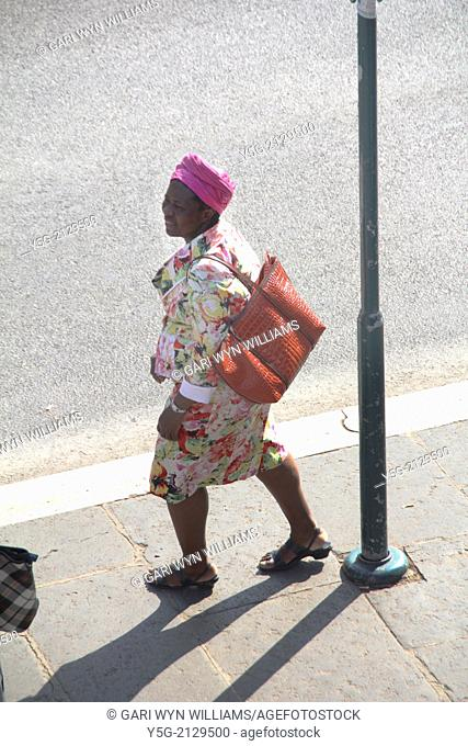 african woman walking in street in rome italy