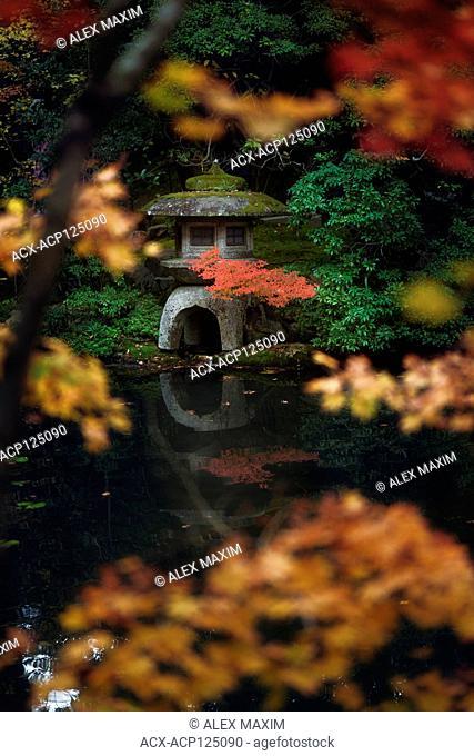 Japanese stone lantern, Ishidoro at Tenjuan Temple pond Zen garden. Example of Japanese Wabi-Sabi aesthetics. Nanzen-ji temple complex in Sakyo-ku, Kyoto