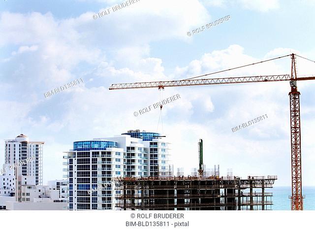 Crane extending over urban construction site