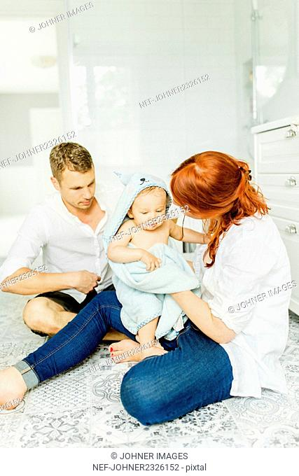 Parents with baby in bathroom